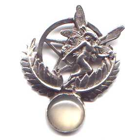 A fairy sets nestled in a large sterling silver pentagram flanked by leaves. A half-inch cats-eye moonstone is mounted below.